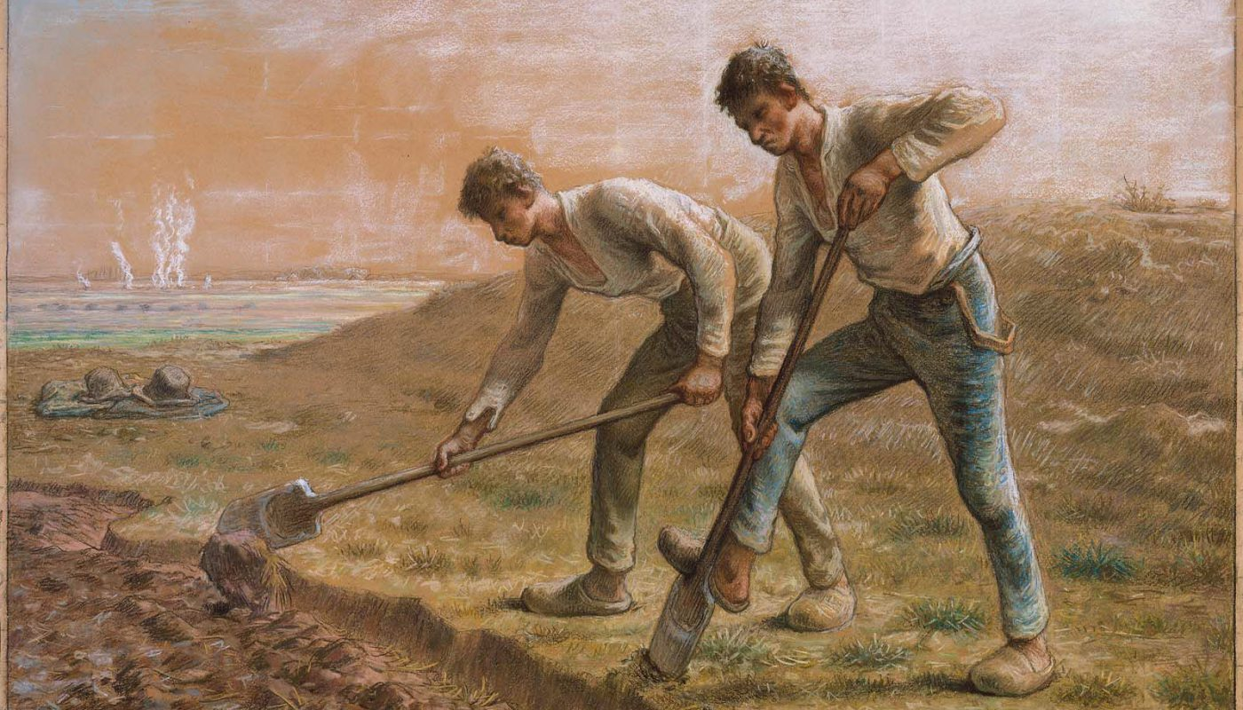 Two men turning over the soil